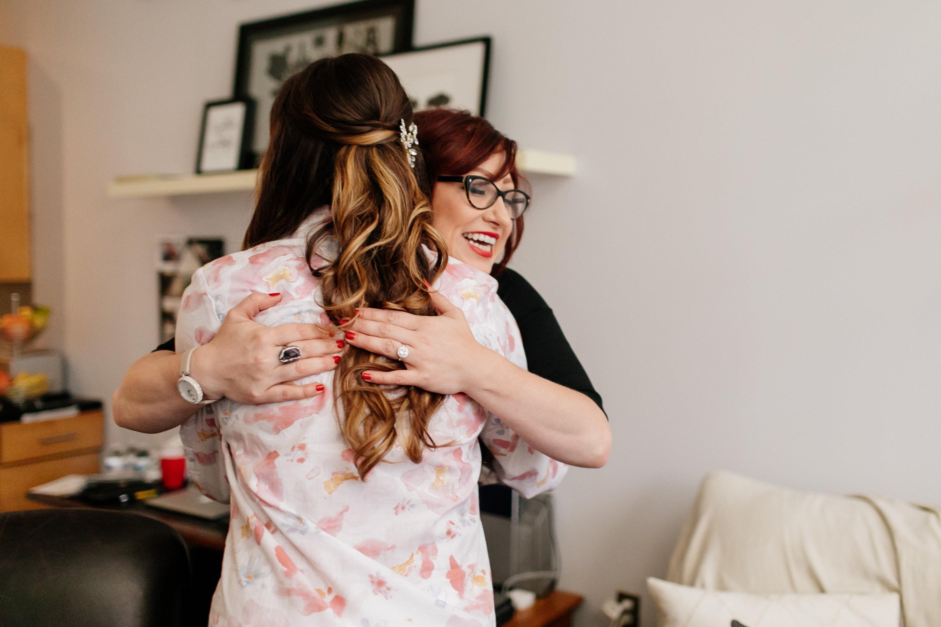Brett Dorrian hugging a client